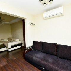 Апартаменты Inzhir Na Vorovskogo 20 Apartments Сочи комната для гостей