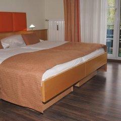 Отель acora Hotel und Wohnen Германия, Дюссельдорф - отзывы, цены и фото номеров - забронировать отель acora Hotel und Wohnen онлайн комната для гостей фото 2