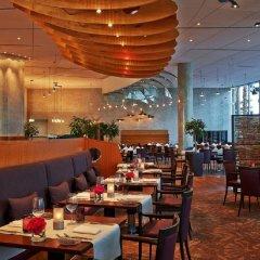 Отель Hilton Munich Airport Германия, Мюнхен - 7 отзывов об отеле, цены и фото номеров - забронировать отель Hilton Munich Airport онлайн питание фото 2