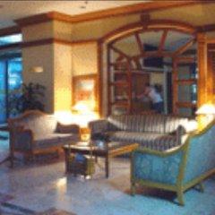 Отель Citadel Inn Makati Филиппины, Макати - отзывы, цены и фото номеров - забронировать отель Citadel Inn Makati онлайн интерьер отеля фото 3