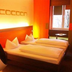 Отель Cocoon Германия, Мюнхен - отзывы, цены и фото номеров - забронировать отель Cocoon онлайн комната для гостей фото 5