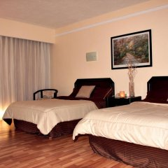 Отель Casa Grande Aeropuerto Hotel & Centro de Negocios Мексика, Гвадалахара - отзывы, цены и фото номеров - забронировать отель Casa Grande Aeropuerto Hotel & Centro de Negocios онлайн комната для гостей фото 5
