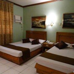Отель Rosas Garden Hotel Филиппины, Манила - отзывы, цены и фото номеров - забронировать отель Rosas Garden Hotel онлайн комната для гостей фото 2