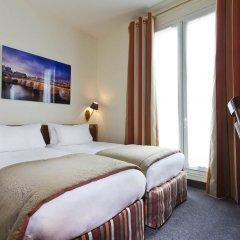 Grand Hotel Des Balcons Париж комната для гостей фото 3