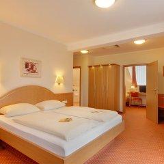 Отель Kriemhild am Hirschgarten Германия, Мюнхен - отзывы, цены и фото номеров - забронировать отель Kriemhild am Hirschgarten онлайн комната для гостей