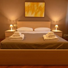 Отель Bed and Breakfast La Villa Бари сейф в номере