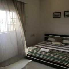 Отель Millennium Apartments Нигерия, Лагос - отзывы, цены и фото номеров - забронировать отель Millennium Apartments онлайн комната для гостей фото 5