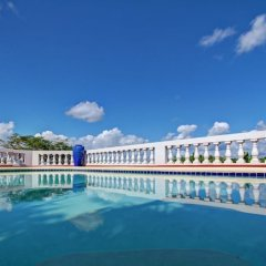 Отель Quadrille, Silver Sands 4BR бассейн