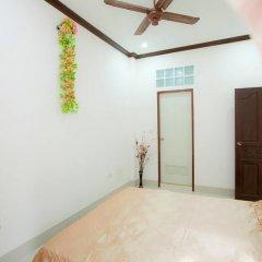 Отель New Era Guesthouse комната для гостей
