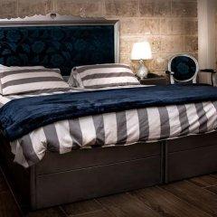 Отель Luciano Al Porto Boutique Accommodation Валетта комната для гостей фото 4