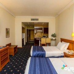 Отель Rolla Residence ОАЭ, Дубай - отзывы, цены и фото номеров - забронировать отель Rolla Residence онлайн комната для гостей фото 4