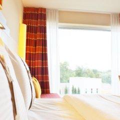 Отель Holiday Inn Express Zurich Airport Швейцария, Рюмланг - 1 отзыв об отеле, цены и фото номеров - забронировать отель Holiday Inn Express Zurich Airport онлайн комната для гостей фото 2