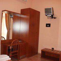 Отель Aristotele сейф в номере