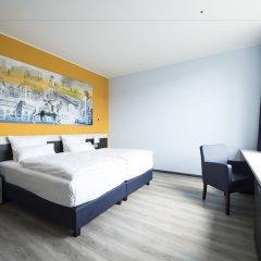 Отель carathotel Düsseldorf City комната для гостей фото 3