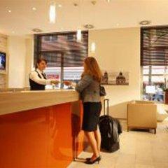 Отель H+ Hotel München Германия, Мюнхен - отзывы, цены и фото номеров - забронировать отель H+ Hotel München онлайн интерьер отеля фото 2
