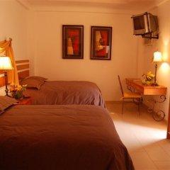 Отель Casa del Arbol Centro Гондурас, Сан-Педро-Сула - отзывы, цены и фото номеров - забронировать отель Casa del Arbol Centro онлайн комната для гостей фото 3