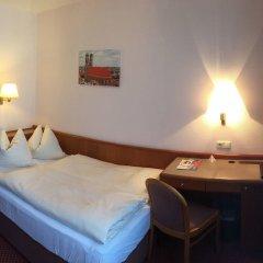 Отель Carmen Германия, Мюнхен - 9 отзывов об отеле, цены и фото номеров - забронировать отель Carmen онлайн удобства в номере фото 2