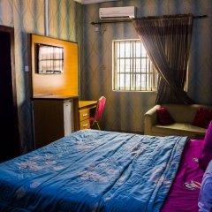 Отель Emglo Suites комната для гостей фото 5