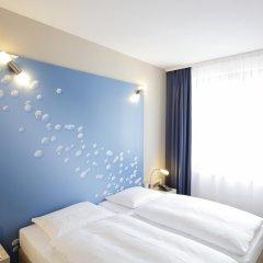 Отель H2 Hotel Berlin-Alexanderplatz Германия, Берлин - 5 отзывов об отеле, цены и фото номеров - забронировать отель H2 Hotel Berlin-Alexanderplatz онлайн комната для гостей фото 2
