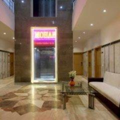 Отель OYO 16011 Hotel Mohan International Индия, Нью-Дели - отзывы, цены и фото номеров - забронировать отель OYO 16011 Hotel Mohan International онлайн фото 2