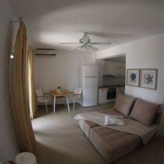 Отель Moriel Seaside Homes Suites Ситония комната для гостей