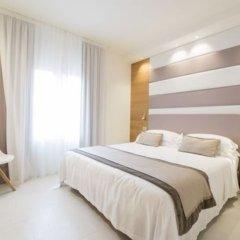 Отель Metropol Ceccarini Suite Риччоне комната для гостей фото 6