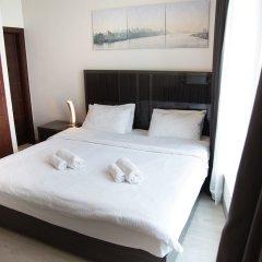 Отель HiGuests Vacation Homes - Burj Views Дубай комната для гостей фото 3