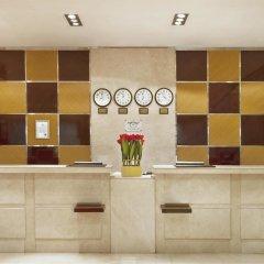 Отель Golden Tulip Sharjah ОАЭ, Шарджа - 1 отзыв об отеле, цены и фото номеров - забронировать отель Golden Tulip Sharjah онлайн интерьер отеля фото 2