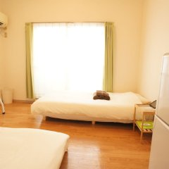 Отель Plus One Fujisaki Фукуока комната для гостей