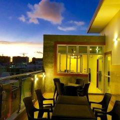 Отель Wavefrontinn Мальдивы, Мале - отзывы, цены и фото номеров - забронировать отель Wavefrontinn онлайн балкон