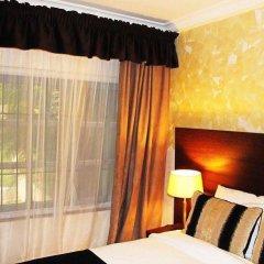 Protea Hotel Apo Apartments комната для гостей