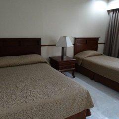 Отель Garden Plaza Hotel Филиппины, Манила - отзывы, цены и фото номеров - забронировать отель Garden Plaza Hotel онлайн комната для гостей фото 4