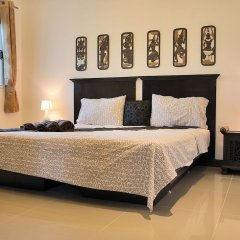 Апартаменты Jungle Apartment 2 Bedrooms комната для гостей