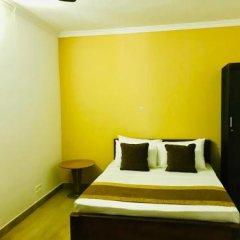 Отель Aradhana Airport Hotel Шри-Ланка, Негомбо - отзывы, цены и фото номеров - забронировать отель Aradhana Airport Hotel онлайн комната для гостей фото 2
