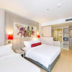 Отель Ramada by Wyndham Phuket Deevana Patong Стандартный номер с различными типами кроватей фото 6
