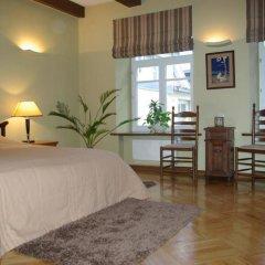 Отель Pilies Apartments Литва, Вильнюс - отзывы, цены и фото номеров - забронировать отель Pilies Apartments онлайн комната для гостей фото 5