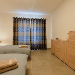 Отель Seafront Apart IN Fort Cambridge Мальта, Слима - отзывы, цены и фото номеров - забронировать отель Seafront Apart IN Fort Cambridge онлайн комната для гостей