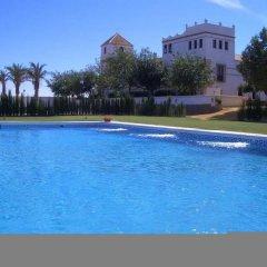 Отель Hacienda Los Jinetes бассейн
