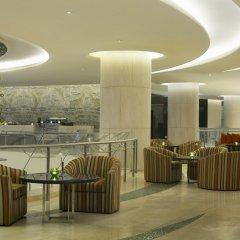 Отель Hilton Capital Grand Abu Dhabi интерьер отеля фото 2
