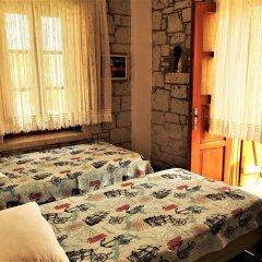 Отель Adres Alacati Otel Чешме комната для гостей
