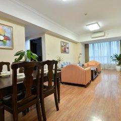 Апартаменты New Harbour Service Apartments комната для гостей