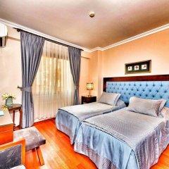 Отель Daphne сейф в номере