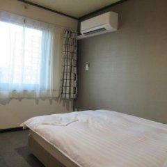 Отель Tomakomai Green Hills Япония, Томакомай - отзывы, цены и фото номеров - забронировать отель Tomakomai Green Hills онлайн комната для гостей фото 5