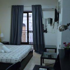 Отель B&B Il Meraviglioso Mondo di Amelie Агридженто сейф в номере