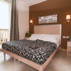 Отель Residence T2 Италия, Римини - 2 отзыва об отеле, цены и фото номеров - забронировать отель Residence T2 онлайн комната для гостей фото 3