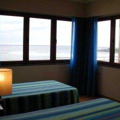 Отель Baia da Barca Apartamentos Turisticos Португалия, Мадалена - отзывы, цены и фото номеров - забронировать отель Baia da Barca Apartamentos Turisticos онлайн комната для гостей