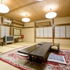 Отель ONSENKAKU Беппу комната для гостей