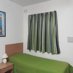 Апартаменты The Seven Apartments комната для гостей