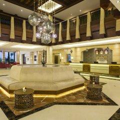 Отель Hilton Al Hamra Beach & Golf Resort интерьер отеля