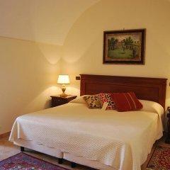 Отель Sangiorgio Resort & Spa Кутрофьяно комната для гостей фото 4